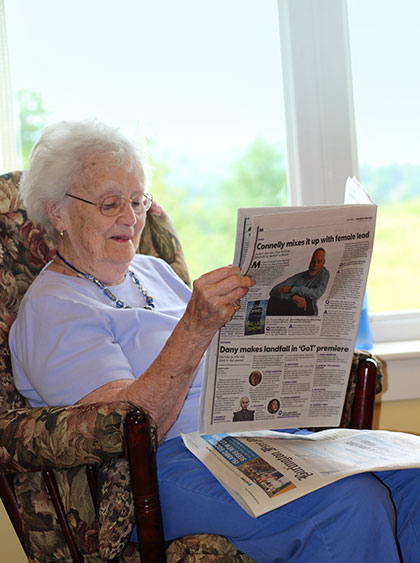 Westview Resident Reading Paper